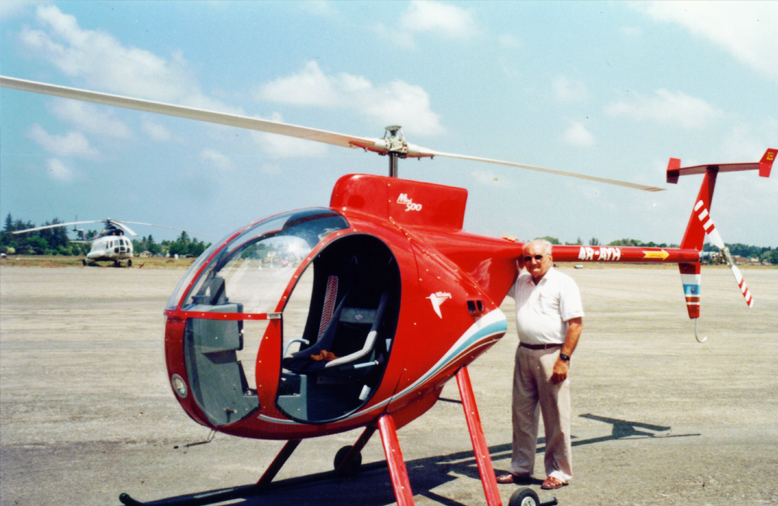 Ray Wijewardene standing besides his home-built helicopter, Sootikka