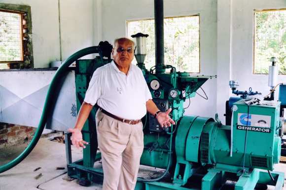 Ray Wijewardene displaying a small scale gasifier in his own estate