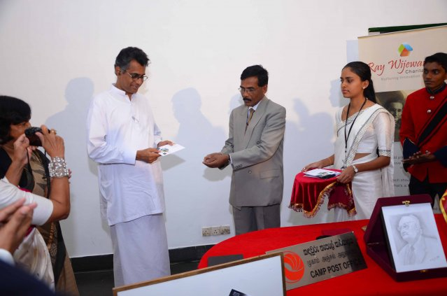 Presenting the First Day Cover and Stamp to Minister of Technology and Research, Patali Champika Ranawaka